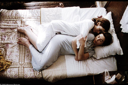 Anna (Nadja Uhl) holds her sister Lotte (Thekla Reuten) in bed together for the first time in 14 years in Miramax Films' TWIN SISTERS. Courtesy: Miramax Films