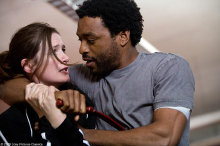 Emily Moriter as Laura Black and Chewitel Ejiofor as Mike Terry in