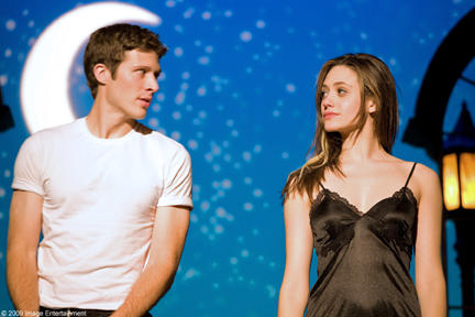 Zach Gilford as Johnny and Emmy Rossum as Alexa in