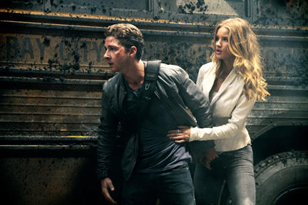 Shia LaBeouf as Sam Witwicky and Rosie Huntington-Whiteley as Carly in