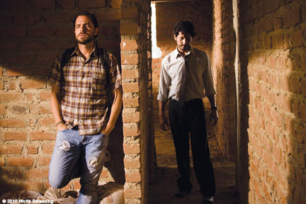Manolo Cardona as Santiago and Cristian Mercado as Miguel in ``Undertow.