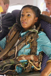 Susan (Faune Chambers) squirms with fright because of the snakes on her plane in
