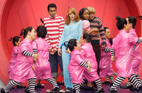 Not-so-young orphans Edward (Kal Penn), Lucy (Jayma Mays), Susan (Faune Chambers) and Peter (Adam Campbell) and the Loompa Oompas in
