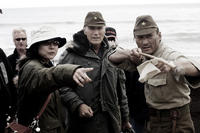Interpreter Yuki Ishimaru, director Clint Eastwood and Ken Watanabe on the set of