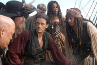 Geoffrey Rush, Orlando Bloom, Naomie Harris, and Johnny Depp in