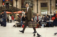 Rowan Atkinson as Mr. Bean in