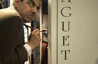 Mr. Bean (Rowan Atkinson), stuck in a familiar position, in