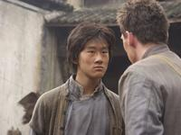 Guang Li as Shi Kai and Jonathan Rhys Meyers as George Hogg in