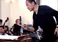 Tan Dun conducts a rehearsal of The First Emperor at an opera workshop in Shanghai in April 2006.