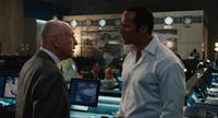 Alan Arkin as The Chief and Dwayne Johnson as Agent 23 in
