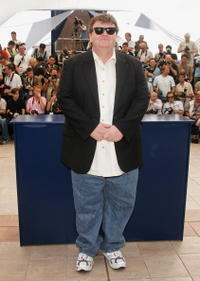 Director Michael Moore at a Cannes photocall for