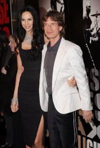 Musician Mick Jagger of the Rolling Stones and L'Wren Scott at the N.Y. premiere of