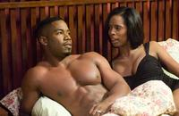 Michael J. White and Tasha Smith in