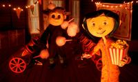Wybie (voiced by Robert Bailey Jr.) and Coraline (voiced by Dakota Fanning) in