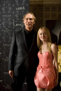 Director Henry Selick and Dakota Fanning at the premiere of