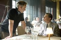 Director Sam Mendes and Leonardo DiCaprio on the set of