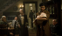 Taraji P. Henson as Queenie, who takes in the very young and very old infant Benjamin in