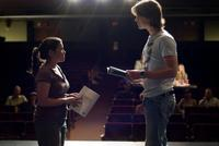 America Ferrera as Carmen and Tom Wisdom as Ian in
