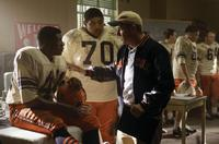 Rob Brown as Ernie Davis, Omar Benson Miller as Jack Buckley and Dennis Quaid as Coach Ben Schwartzwalder in