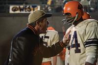 Dennis Quaid as Coach Ben Schwartzwalder and Rob Brown as Ernie Davis in