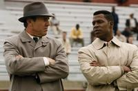 Dennis Quaid as Coach Ben Schwartzwalder and Darrin Dewitt Henson as Jim Brown in