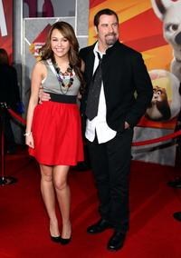 Miley Cyrus and John Travolta at the California premiere of