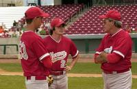 Powers Boothe as Jim Van Scoyoc giving a pep talk to his players in