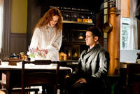 Jessica Brown Findlay as Beverly Penn and Colin Farrell as Peter Lake in