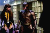 Malin Akerman as Silk Spectre II and Patrick Wilson as Nite Owl in