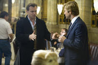 Director Christopher Nolan and Aaron Eckhart on the set of