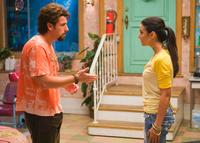 Adam Sandler as Zohan and Emmanuelle Chriqui as Dalia in