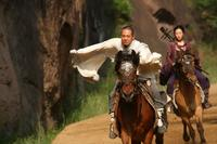 Jet Li as Silent Monk and Crystal Liu as Golden Sparrow in