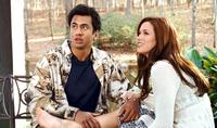 Kal Penn as Kumar and Danneel Harris as Vanessa in