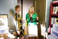 Cynthia Nixon as Miranda Hobbes and Kim Cattrall as Samantha Jones in
