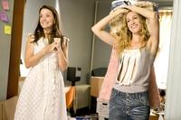 Kristin Davis as Charlotte York-Goldenblatt and Sarah Jessica Parker as Carrie Bradshaw in