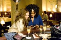 Sarah Jessica Parker as Carrie Bradshaw and Jennifer Hudson as Louise in