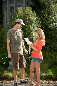 Director John Schultz and Ashley Tisdale on the set of