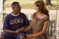 Martin Lawrence as RJ and Nicole Ari Parker as Lucinda in