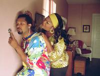 Mike Epps as Reggie and Monique as Betty in