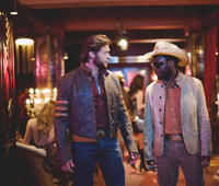 Hugh Jackman as Wolverine and Will.i.am as John Wraith in