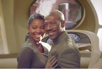 Eddie Murphy as Dave Ming Chang and Gabrielle Union in