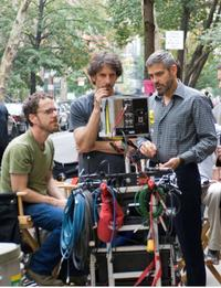 Directors Ethan and Joel Coen with George Clooney on the set of