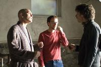 John Malkovich and Directors Ethan and Joel Coen on the set of