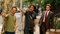 Directors Ethan and Joel Coen with Brad Pitt on the set of