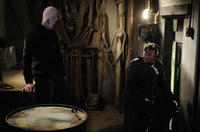 Tobin Bell as Jigsaw and Costas Mandylor as Hoffman in