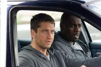 Gerard Butler as One Two and Idris Elba as Mumbles in