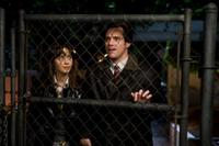 Zooey Deschanel as Allison and Jim Carrey as Carl Allen in