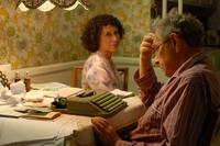 Rhea Perlman as Reisele and Otto Tausig in