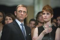 Daniel Craig as James Bond 007 and Gemma Arterton as Fields in