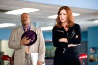 Ving Rhames as Jibby Newsome and Kathryn Hahn as Babs Merrick in
